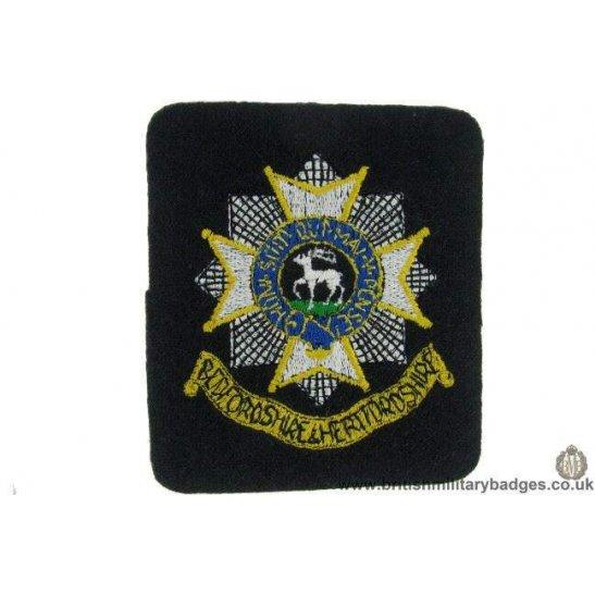 R1B/19 - Bedfordshire & Hertfordshire Regiment Blazer Badge